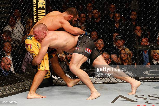 Georges StPierre takes down Johny Hendricks in their UFC welterweight championship bout during the UFC 167 event inside the MGM Grand Garden Arena on...