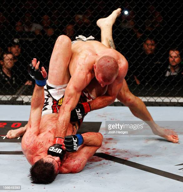 Georges StPierre throws a punch to the face of Carlos Condit in their welterweight title bout during UFC 154 on November 17 2012 at the Bell Centre...