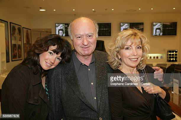 Georges Wolinski with his wife Maryse and their daughter Elsa at the opening of the 'Espace Franck Provost' at Galeries Lafayette in Paris