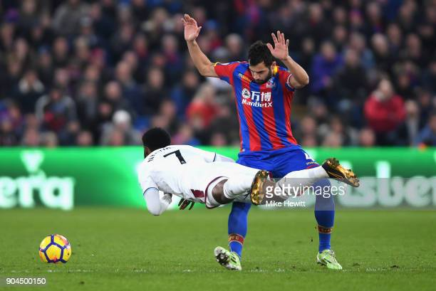 GeorgesKevin N'Koudou of Burnley is challenged by Luka Milivojevic of Crystal Palace during the Premier League match between Crystal Palace and...