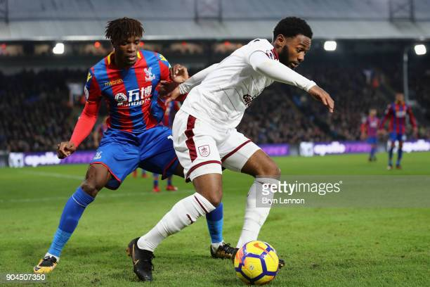 GeorgesKevin N'Koudou of Burnley is challenged by Wilfried Zaha of Crystal Palace during the Premier League match between Crystal Palace and Burnley...