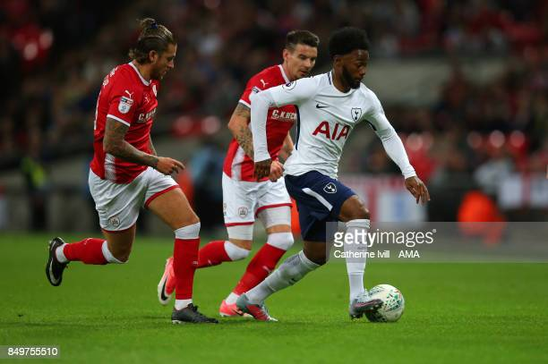 GeorgesKevin N'Koudou of Tottenham Hotspur gets away from George Moncur and Adam Hammill of Barnsley during the Carabao Cup Third Round match between...