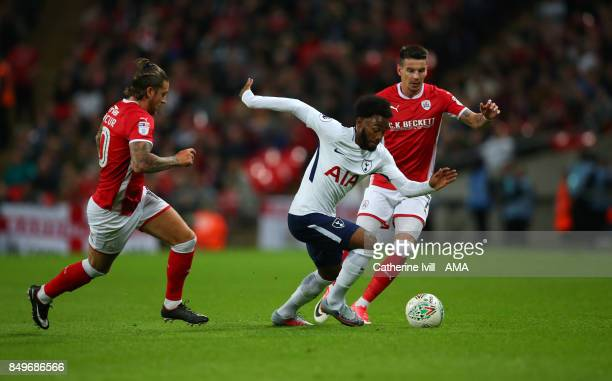GeorgesKevin N'Koudou of Tottenham Hotspur gets past George Moncur and Adam Hammill of Barnsley during the Carabao Cup Third Round match between...