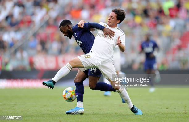 Georges-Kévin Nkoudou of Tottenham Hotspur competes with Alvaro Odriozola of Real Madrid during the Audi Cup 2019 semi final match between Real...