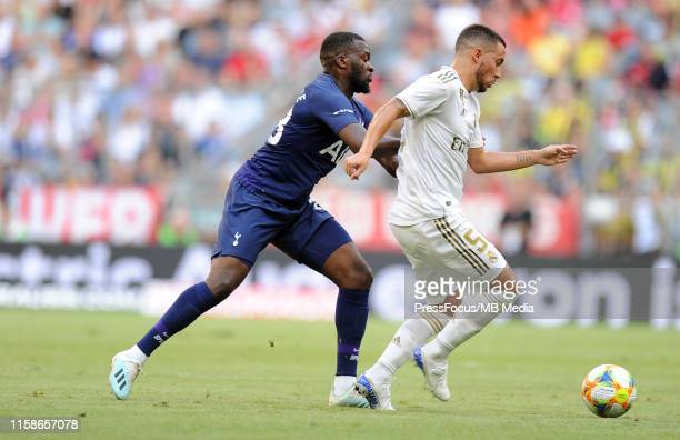 Georges-Kévin Nkoudou of Tottenham Hotspur competes with Eden Hazard of Real Madrid during the Audi Cup 2019 semi final match between Real Madrid and...