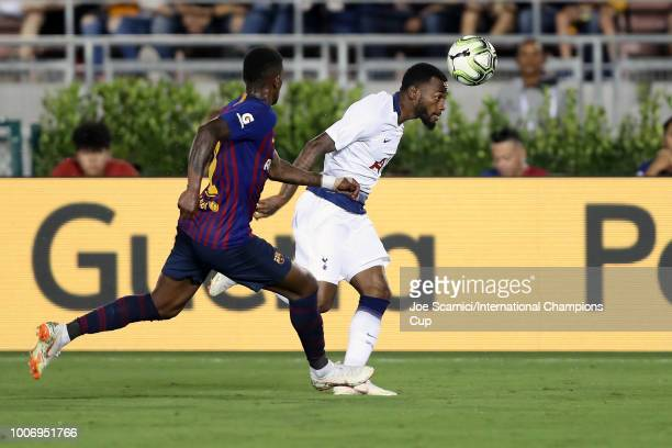 Georges-Kévin N'Koudou of Tottenham Hotspur heads the ball in front of Nelson Semedo of FC Barcelona during an International Champions Cup match at...