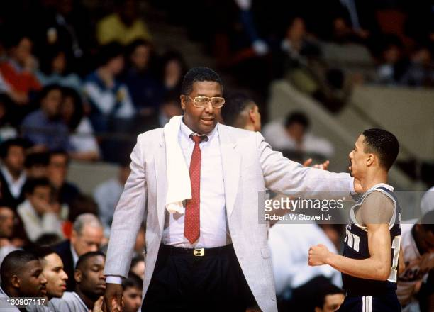 Georgetown coach John Thompson confers on the sideline with point guard Charles Smith during a game against the University of Connecticut Hartford...