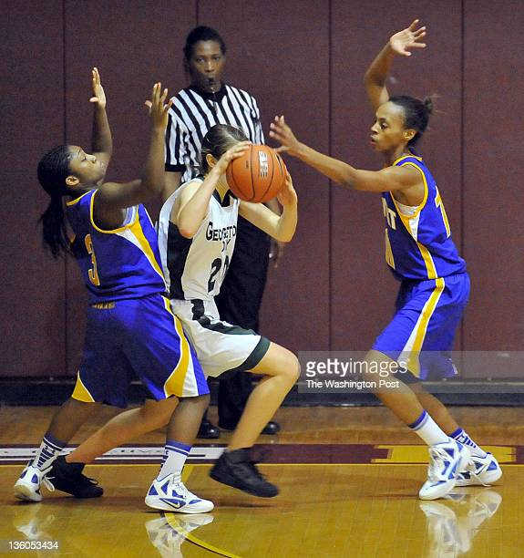 Georgetown Day's Courtney Bell is doubleteamed by Calvert's Jasmine Weems and Taira Lester as she bring the ball up court on December 17 2011 in...