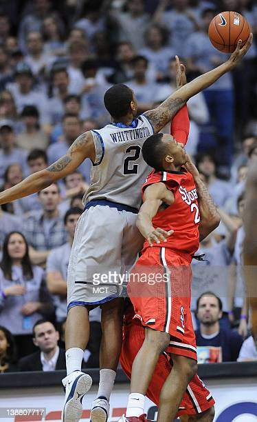 Georgetown forward Greg Whittington goes over the back of St John's forward Amir Garrett to pull down a rebound during firsthalf action at the...