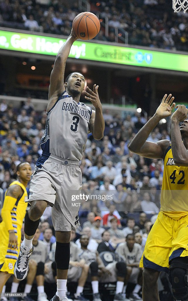 Georgetown forward Mikael Hopkins (3) lays up a score against Marquette center Chris Otule (42) in the second half at the Verizon Center in Washington, D.C., Monday, February 11, 2013. Georgetown defeated Marquette, 63-55.