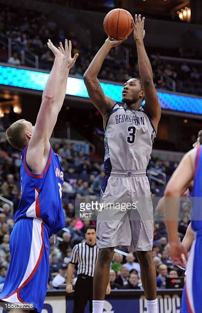 Georgetown forward Mikael Hopkins scores over American University forward Stephen Lumpkins left in the second half at the Verizon Center in...