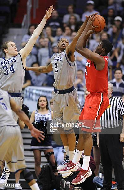 Georgetown forward Nate Lubick and Georgetown forward Greg Whittington defend a jump shot by St John's guard/forward Moe Harkless during secondhalf...