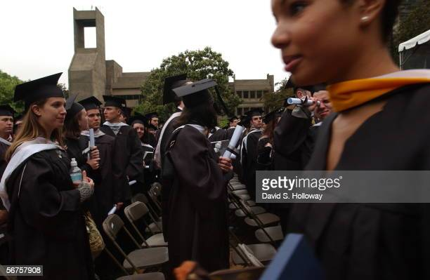 Georgetown Graduate Sean McGrane uses his mock diploma as a spyglass to watch female classmates as the march out of the commencement ceremony and...