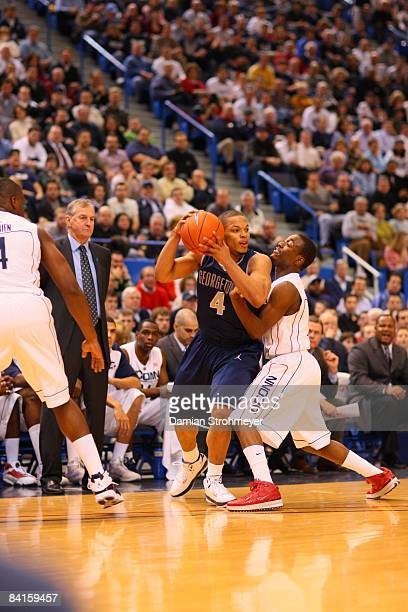 Georgetown guard Chris Wright is pressured by Connecticut guard Kemba Walker NCAA Basketball Georgetown at UConn Monday game action Storrs CT...