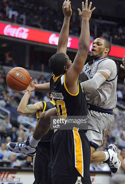 Georgetown guard Chris Wright right dishes the ball off around Appalachian State forward Andre Williamson during secondhalf action at the Verizon...