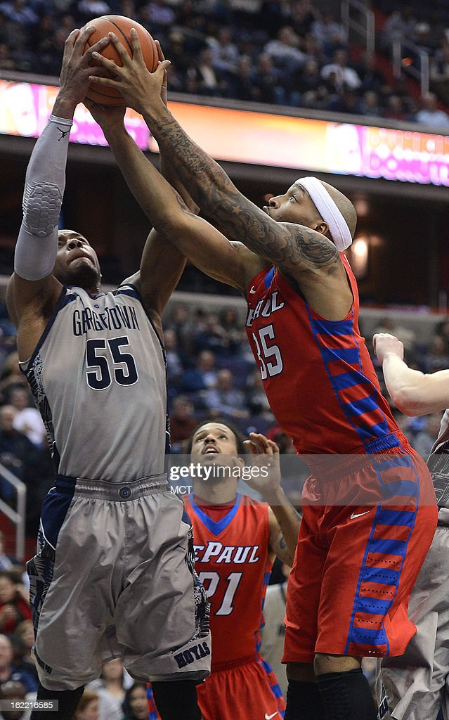 Georgetown guard Jabril Trawick (55) and DePaul forward Montray Clemons (35) reach for a rebound in the second half at the Verizon Center in Washington, D.C., Wednesday, February 20, 2013. Georgetown defeated DePaul, 90-66.