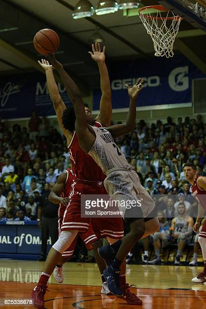 Georgetown guard Jonathan Mulmore scores in the paint and is fouled during the semi final round of the Maui Invitational game between Wisconsin vs...