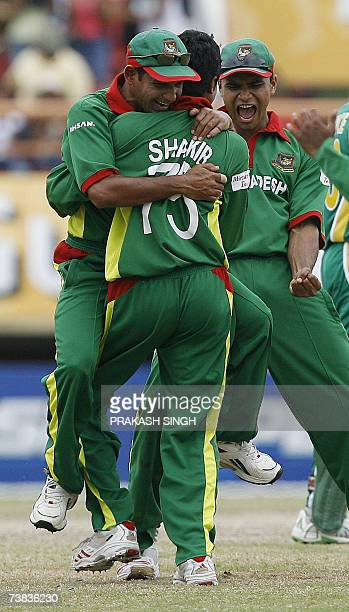 Bangladesh's cricket Captain Habibul Bashar hugs Sakib Al Hasan for the wicket of South Africa's Justin Kemp as Mashrafee Murtaza celebrates during...