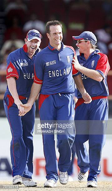 England's Paul Collingwood and Ian Bell congratulate Captain Michael Vaughan for the wicket of Ireland's Niall O'Brien during the SuperEight match at...