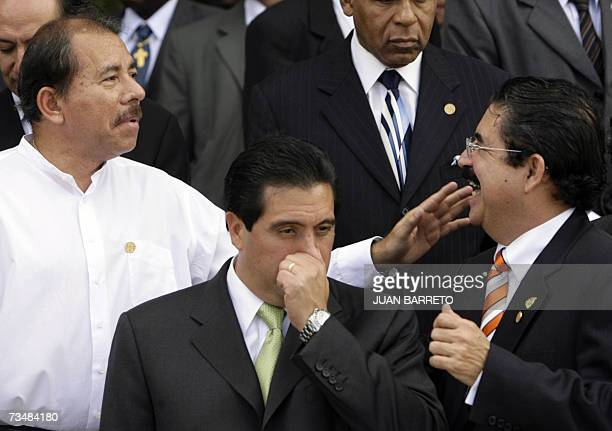 Honduran President Manuel Zelaya jokes with his Nicaraguan counterpart Daniel Ortega during the official picture of the Rio Group Summit in...