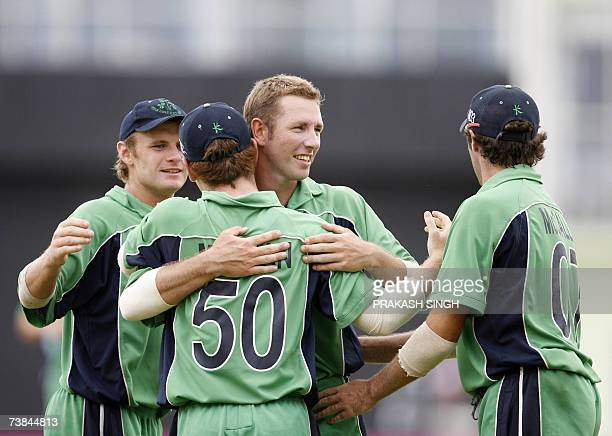 Ireland's Andrew White celebrates after taking the wicket of New Zealand's Jacob Oram during the SuperEight match at Guyana National Stadium in...