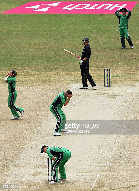 Irish players react to missing a runout opportunity against New Zealand during the SuperEight match at Guyana National Stadium in Georgetown Guyana...