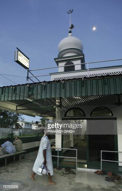 This picture taken on 29 March 2007 shows a Muslim man walking into a mosque for evening prayer in Georgetown Guyanese Muslims dreamed of watching...