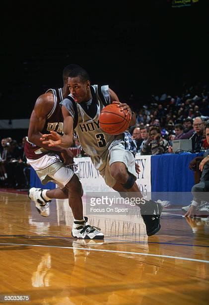 Georgetown Hoyas' Allen Iverson dribbles his way to the basket during a game