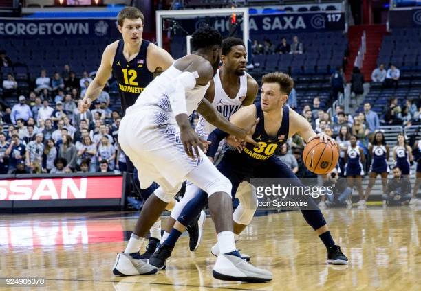 Georgetown Hoyas center Jessie Govan and guard Trey Dickerson block the progress of Marquette Golden Eagles guard Andrew Rowsey during a Big East...