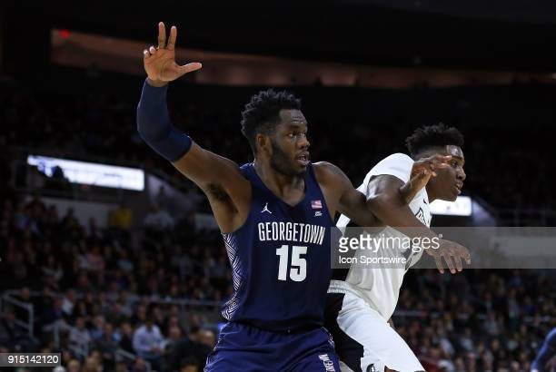 Georgetown Hoyas center Jessie Govan and Providence Friars forward Kalif Young battle for position during a college basketball game between...