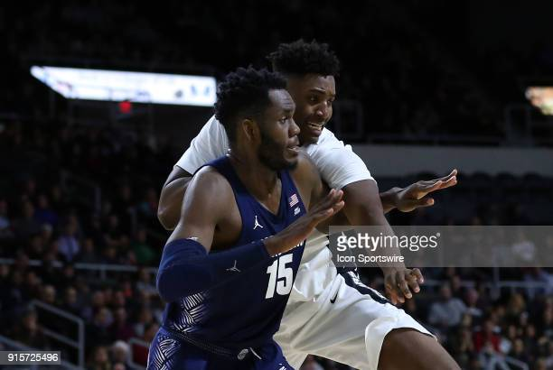Georgetown Hoyas center Jessie Govan and Providence Friars forward Kalif Young battle for positon during a college basketball game between Georgetown...