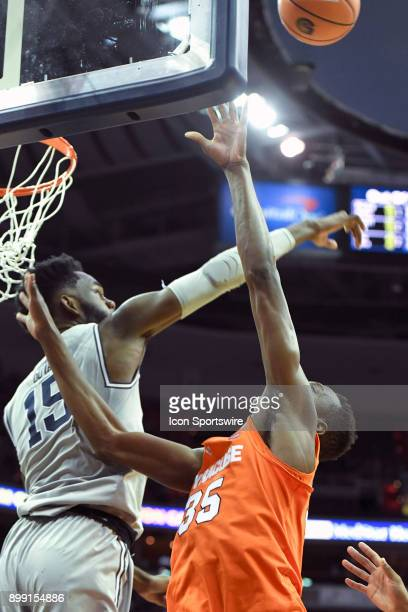 Georgetown Hoyas center Jessie Govan blocks a first half shot by Syracuse Orange forward Bourama Sidibe on December 16 at the Capital One Arena in...