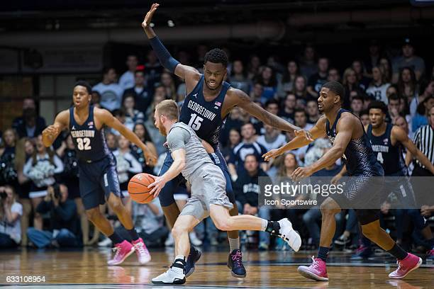 Georgetown Hoyas center Jessie Govan blocks Butler Bulldogs guard Tyler Lewis during the men's college basketball game between the Butler Bulldogs...