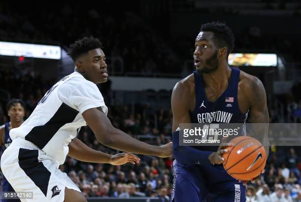 Georgetown Hoyas center Jessie Govan defended by Providence Friars forward Kalif Young during a college basketball game between Georgetown Hoyas and...