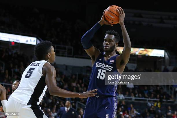 Georgetown Hoyas center Jessie Govan defended by Providence Friars forward Rodney Bullock during a college basketball game between Georgetown Hoyas...