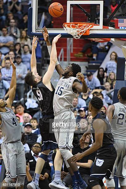 Georgetown Hoyas center Jessie Govan fouls Butler Bulldogs center Nate Fowler in overtime on January 7 at the Verizon Center in Washington DC The...