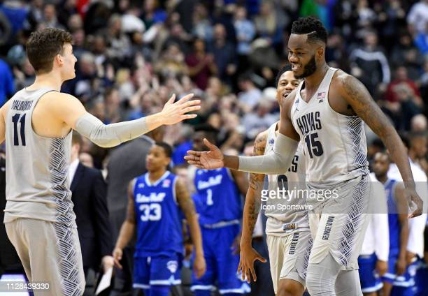 Georgetown Hoyas center Jessie Govan is congratulated by guard Greg Malinowski following the double overtime win against the Seton Hall Pirates on...