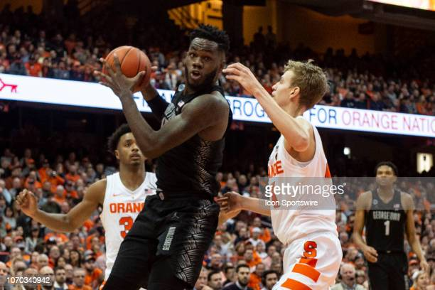 Georgetown Hoyas Center Jessie Govan makes a move toward the basket with Syracuse Orange Forward Marek Dolezaj defending during the first half of the...
