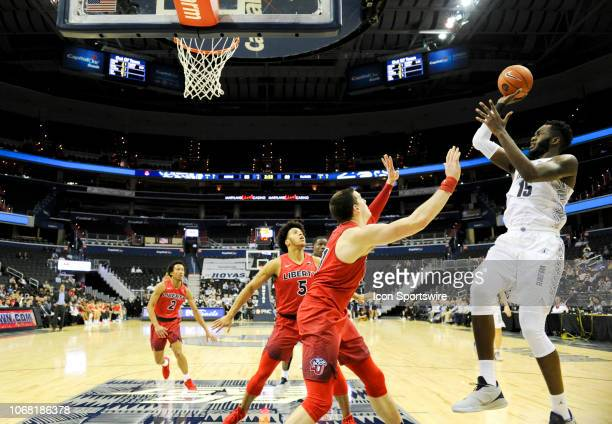 Georgetown Hoyas center Jessie Govan scores over Liberty Flames forward Scottie James in the second half on December 3 at the Capital One Arena in...