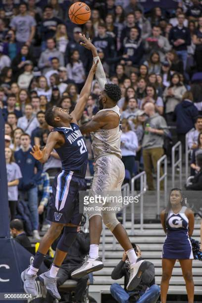 Georgetown Hoyas center Jessie Govan scores over Villanova Wildcats forward Dhamir CosbyRoundtree on January 17 at the Capital One Arena in...