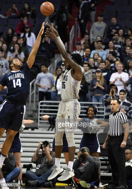 Georgetown Hoyas center Jessie Govan scores over Villanova Wildcats forward Omari Spellman in the first half on January 17 at the Capital One Arena...