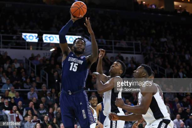 Georgetown Hoyas center Jessie Govan shoots over Providence Friars forward Rodney Bullock during a college basketball game between Georgetown Hoyas...
