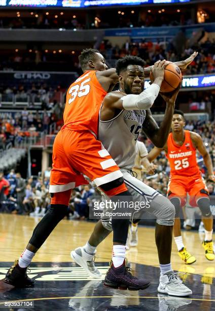 Georgetown Hoyas center Jessie Govan twists past Syracuse Orange forward Bourama Sidibe during a college basketball game between Georgetown...