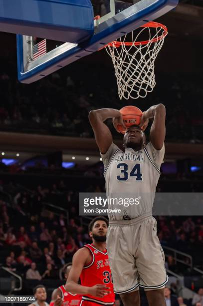 Georgetown Hoyas center Qudus Wahab dunks the ball during the Big East tournament first round game between the St. Johns Red Storm and Georgetown...