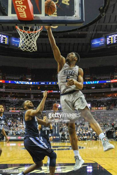 Georgetown Hoyas forward Antwan Walker scores against Villanova Wildcats guard Mikal Bridges on January 17 at the Capital One Arena in Washington DC...