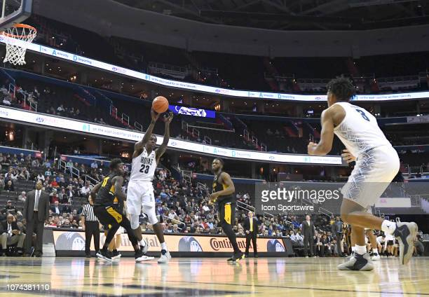 Georgetown Hoyas forward Josh LeBlanc passes to guard James Akinjo in the second half against the Appalachian State Mountaineers on December 18 at...