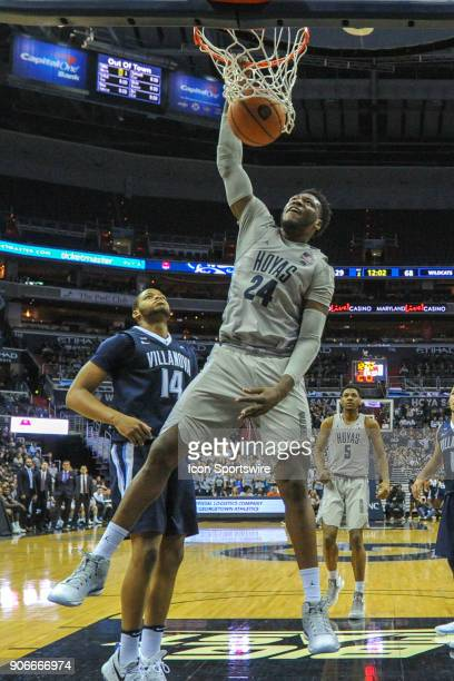 Georgetown Hoyas forward Marcus Derrickson scores in the second half against Villanova Wildcats forward Omari Spellman on January 17 at the Capital...