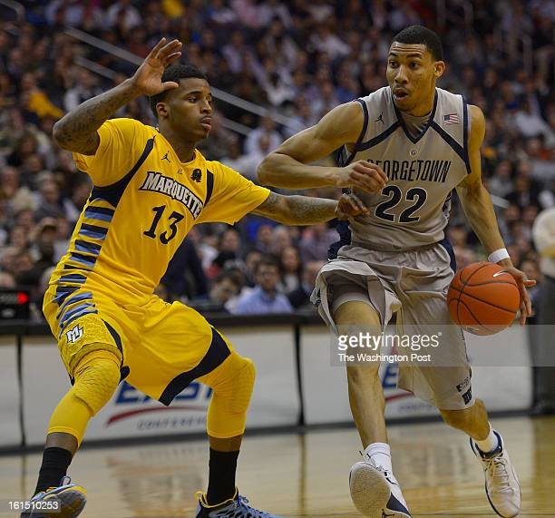 Georgetown Hoyas forward Otto Porter Jr drives to the basket past Marquette Golden Eagles guard Vander Blue in the second half during a game between...
