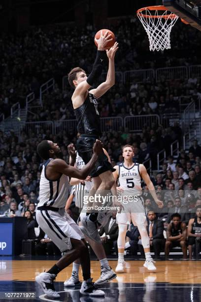 Georgetown Hoyas guard Greg Malinowski drives by Butler Bulldogs guard KamarBaldwin for a layup during the men's college basketball game between the...