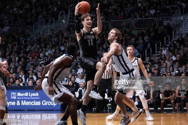 Georgetown Hoyas guard Greg Malinowski drives by Butler Bulldogs forward JoeyBrunk in the lane during the men's college basketball game between the...